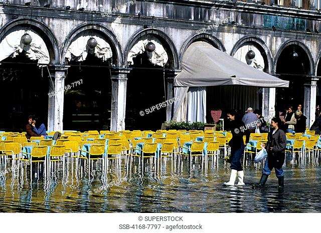 Italy, Venice, Piazza San Marco, People walking in water