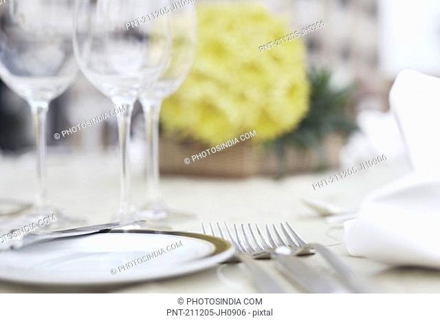 Close-up of cutlery and crockery on the dining table