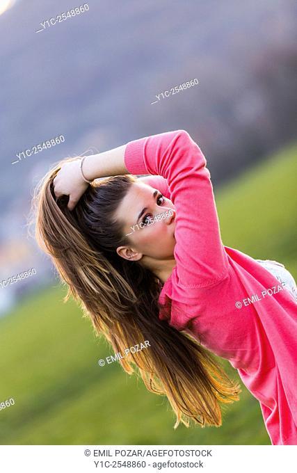 Looking back over shoulder female teenager