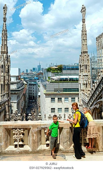 Family excursion to the roof of Milan Cathedral (or Duomo di Milano). Construction began in 1386, but it ended only in 1813