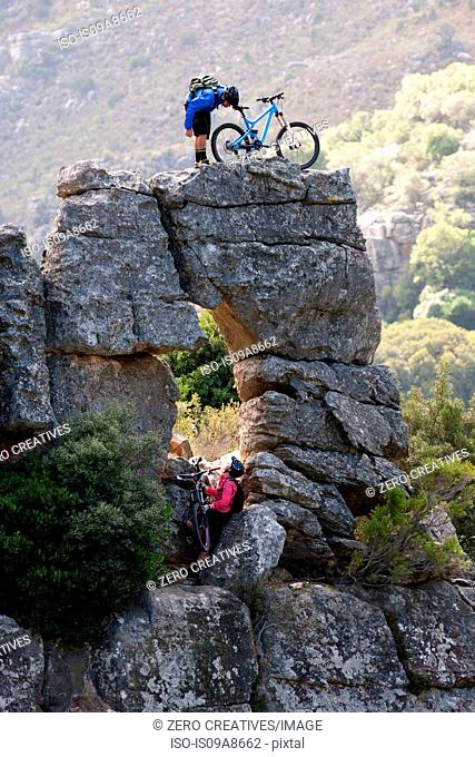 Mountain biking couple on rock formation