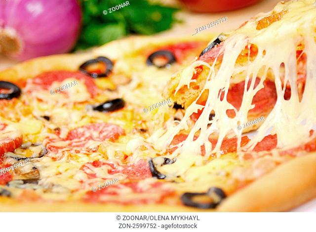 Pepperoni pizza with mushrooms, peppers and olives