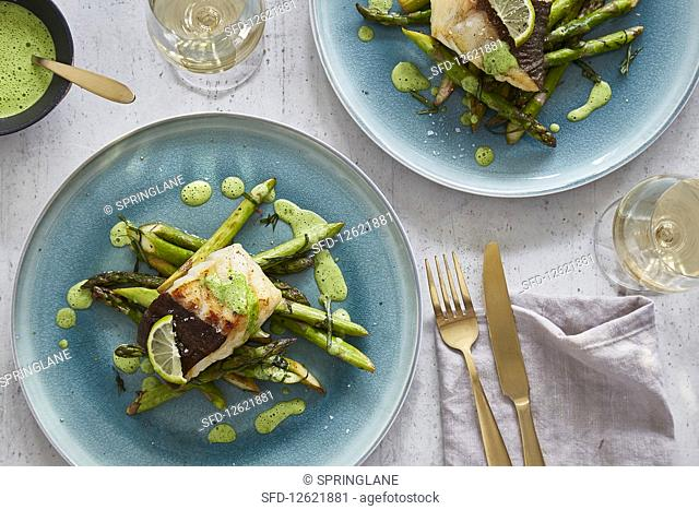 Cod fillet with wild garlic sauce and asparagus