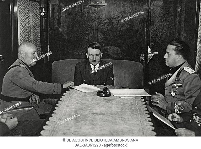 Benito Mussolini, Adolf Hitler and Galeazzo Ciano in Hitler 's railway carriage during the meeting at the Brenner Pass, March 18, 1940, Austria, Italy