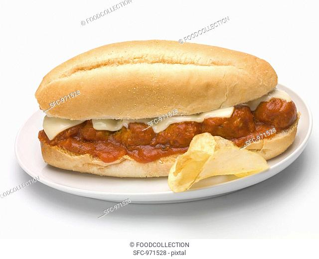 Meatball sub sandwich with tomato sauce and cheese, crisps