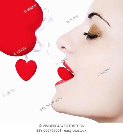 young beautiful caucasian woman playing with heart and love