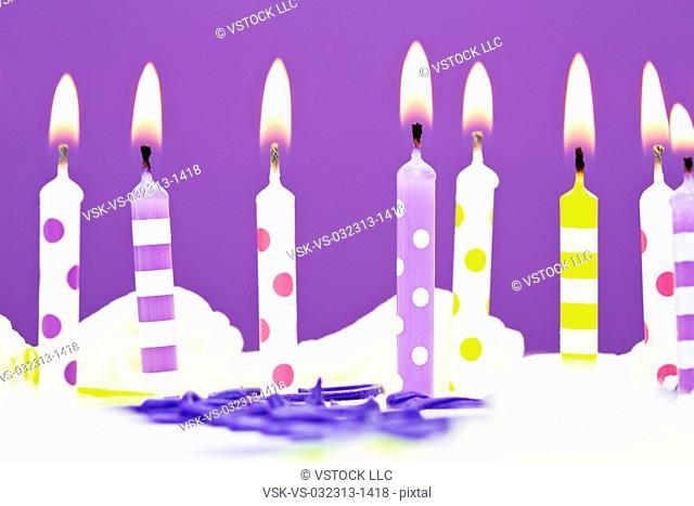 Burning candles on cake