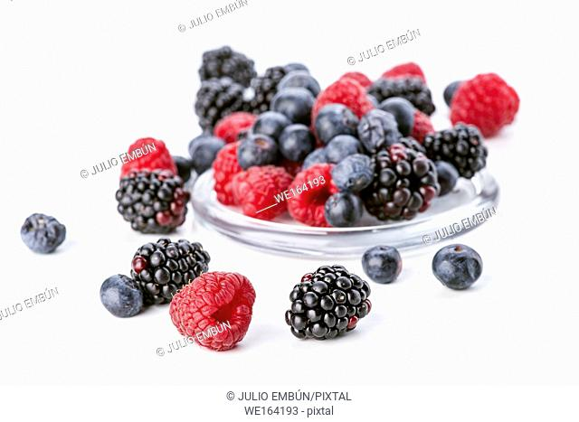 blueberries blackberries and raspberries isolated on white background