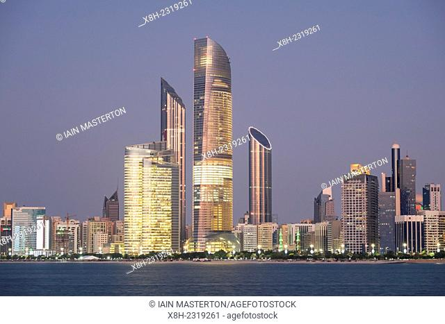 Skyline of modern buildings along Corniche waterfront in Abu Dhabi United Arab Emirates