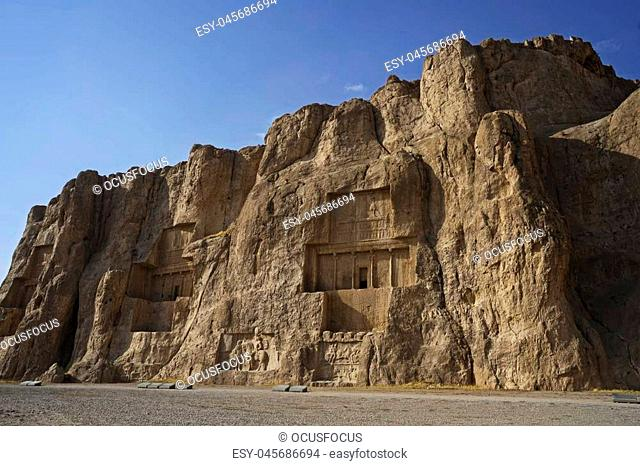 Naqsh-e Rustam Persian ancient necropolis northwest of Persepolis in Fars Province Iran with ancient Iranian rock relief in the cliff from Achaemenid Empire and...