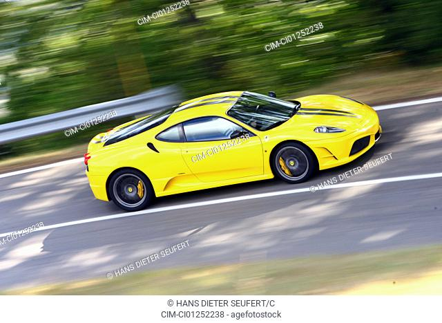 Ferrari 430 Scuderia, model year 2007-, yellow, driving, side view, country road