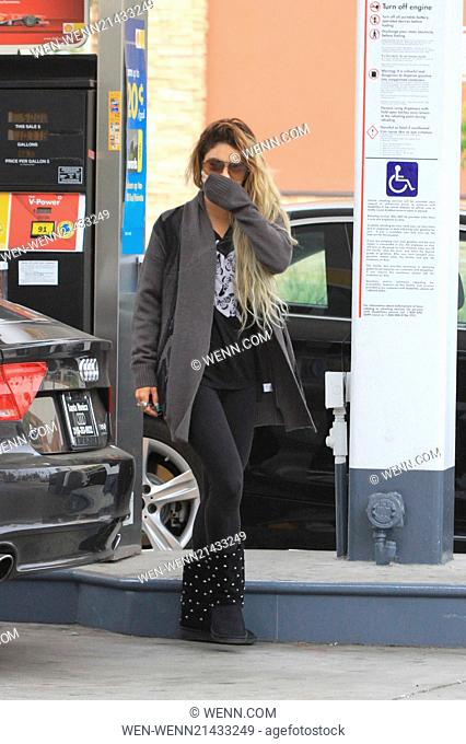 Vanessa Hudgens leaves her yoga class and fills up her car with gas covering her face with her hand Featuring: Vanessa Hudgens Where: United States When: 06 Jun...