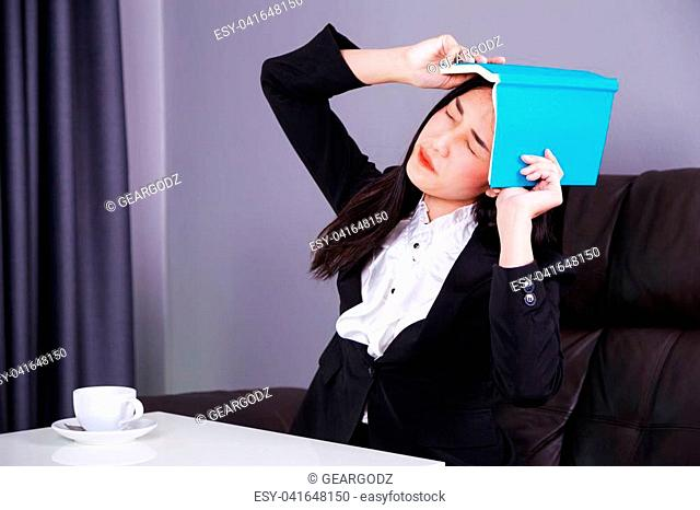 frustrated business woman with a book