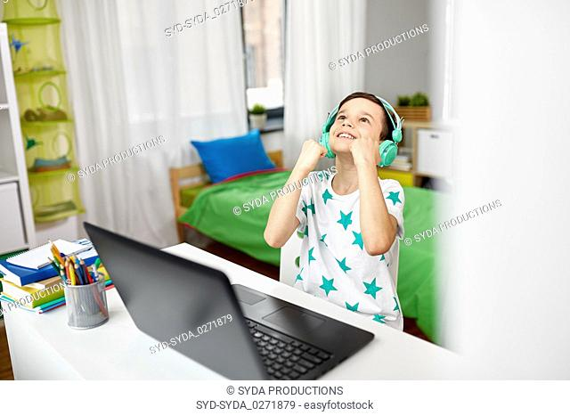 boy celebrating victory in computer video game