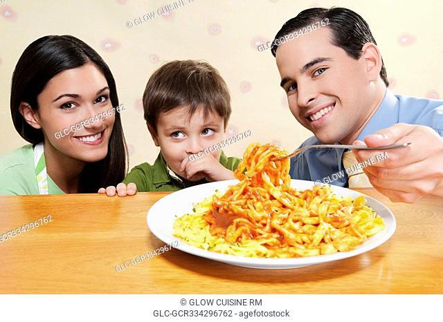 Family sharing fettuccine pasta