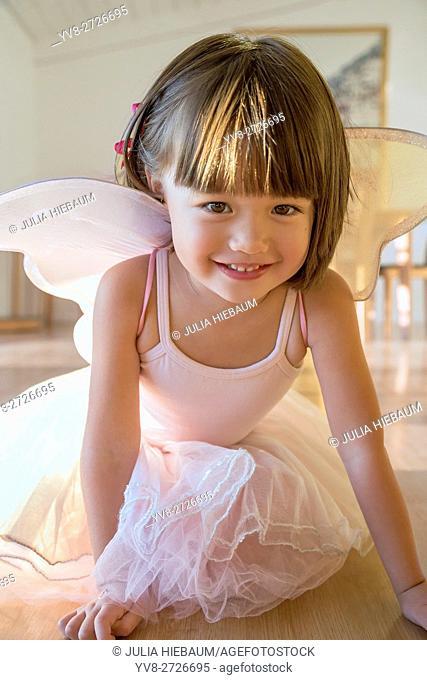 Toddler girl wearing her fairy costume