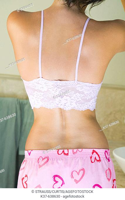 Backview of small of back of woman wearing lacey camisole & shorts with hearts