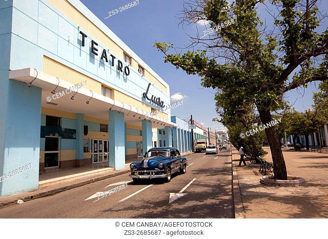 Old American car in front of the Teatro Luisa-Luisa Theatre at the Paseo del Prado or so called Boulevard, Cienfuegos, Cuba, West Indies, Central America