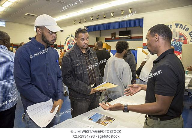 Detroit, Michigan USA - 5 August 2017 - Job seekers crowded the United Auto Workers Local 22 union hall for a job fair directed in part towards those who have a...