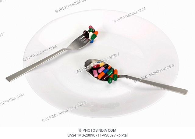Assorted capsules in a plate