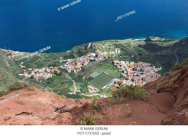High angle view of town by sea seen from mountain peak, Agulo, Island La Gomera, Spain