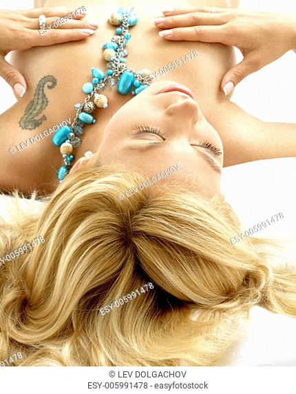portrait of dreaming blond laying in bed