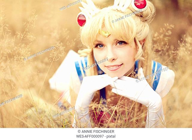 Portrait of smiling woman wearing costume of Pretty Guardian Sailor Moon