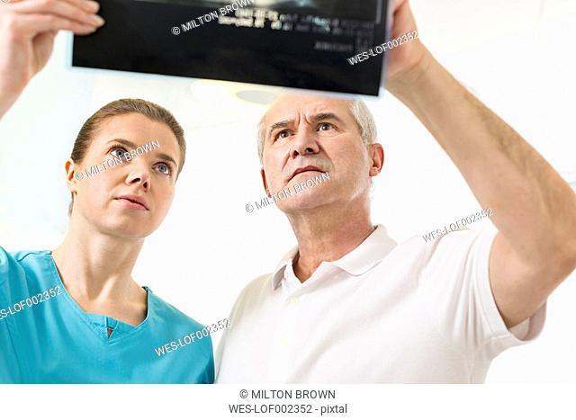 Two medics looking at x-ray image