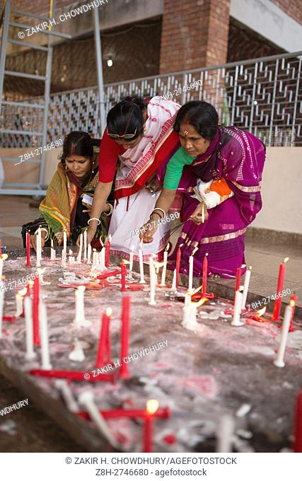 DHAKA, BANGLADESH - OCTOBER 09 : Bangladeshi hindu people offers prayers as part of rituals during the third day of the five-day-long religious festival of...