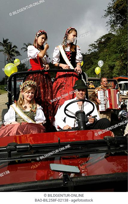 A family in traditional Tacht at the public festival by the Martin's day in the mountain village in the German colony Colonia Tovar in the nebulous woods to the...