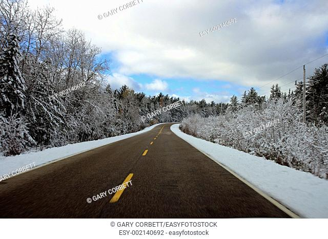 a highway with snow all around it