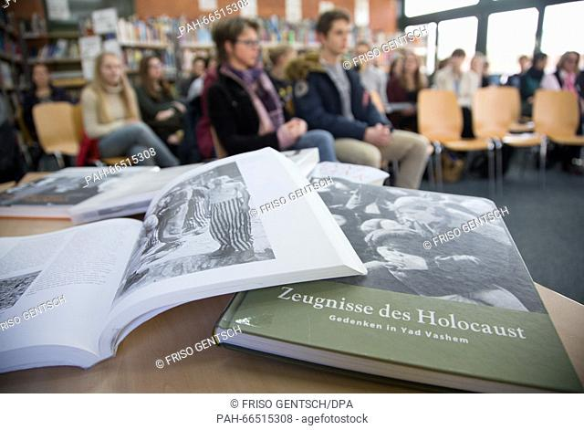 The book 'Holocaust Witnesses'can be seen on a table during a talk by Ernst von Muenchhausen, lawyer with the accessory prosecution in the trial against a...