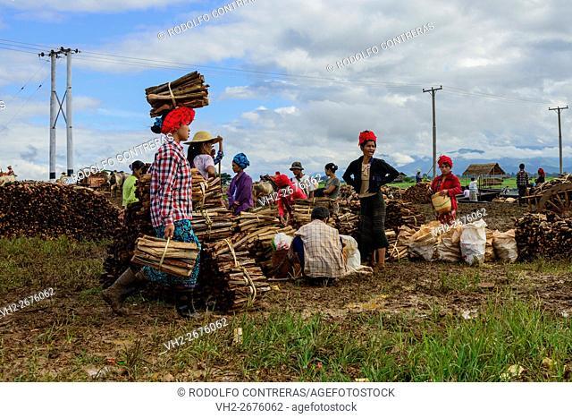 Wood sellers at Inle Lake market, Myanmar