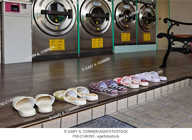 Slippers arranged for customers to wear at coin laundry, Tosu, Saga, Japan