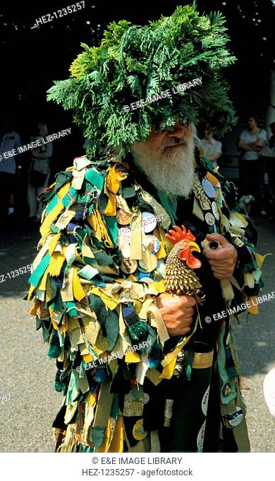 'Green Man', morris man, Ashford in the Water, Derbyshire. The Green Man in European culture originated as a pagan god associated with natural rebirth in the...