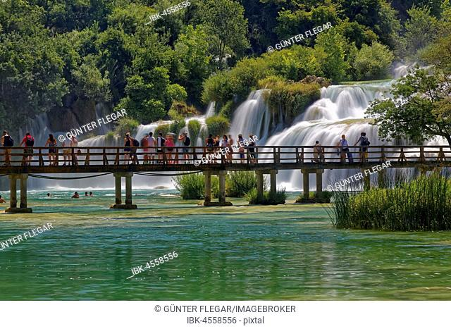 Tourists bathe at the waterfall Smotorcycleinski Buk, National Park Krka, Sibenik-Knin, Dalmatia, Croatia