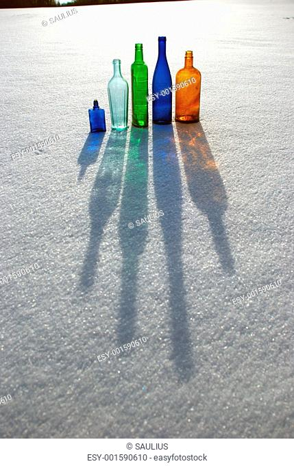 Colored bottles on snow