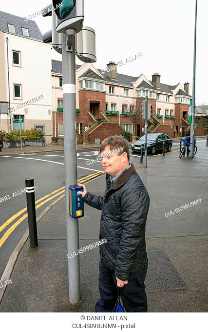 Man with down syndrome at pedestrian crossing, Galway, Ireland