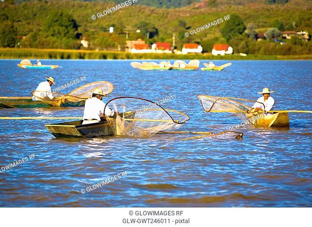 Fishermen fishing in a lake, Lake Patzcuaro, Patzcuaro, Michoacan State, Mexico