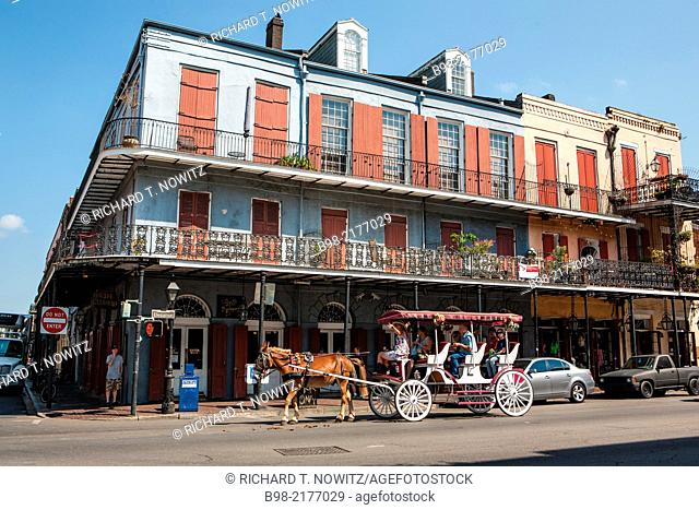 Horse drawn carriage on carries tourists in the French Quarter of New Orleans, Louisiana