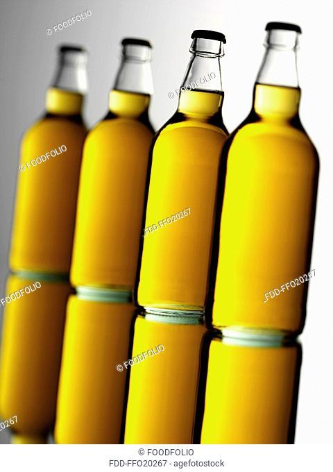Four Cider Bottles