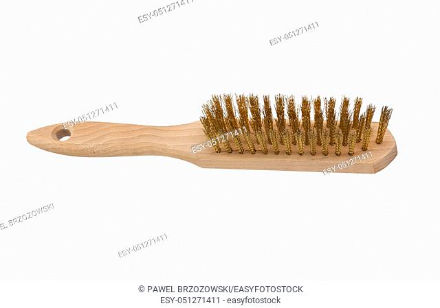 Wire brush with wooden handle isolated on a white background. Metal wire brush for rust removal