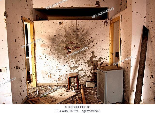 Grenade blast and bullet marks at nariman house jewish community centre by deccan mujahedeen terrorists attack in Bombay Mumbai  ; Maharashtra  ; India...