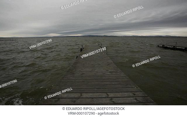 Pier of lake in a cloudy day