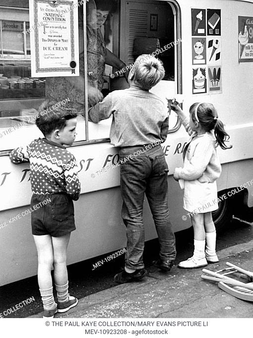 6c92e658fb Children buying ice cream from an ice cream van on a Balham street