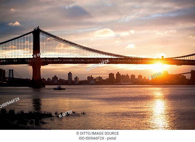 Sunset behind Manhattan bridge, New York City, USA