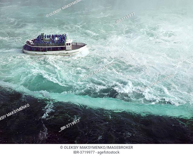 Tour boat approaching the Niagara Falls Horseshoe edge, Niagara Falls, Ontario Province, Canada