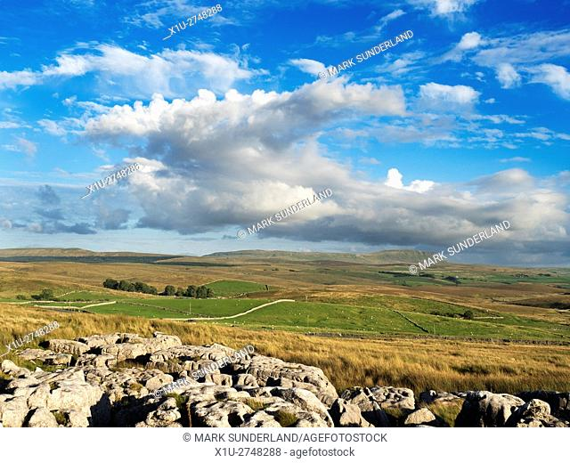 Blue Sky and White Clouds over Pen Y Ghent from Ribblehead Yorkshire Dales England