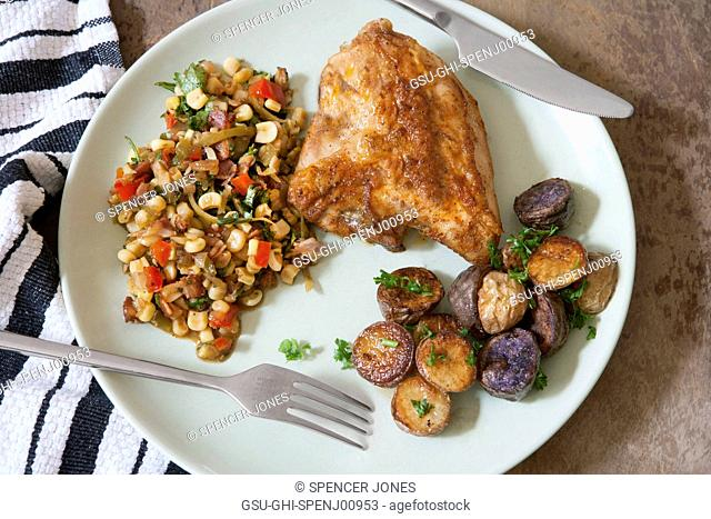 High Angle View of Roasted Chicken, Potatoes and Succotash on Plate