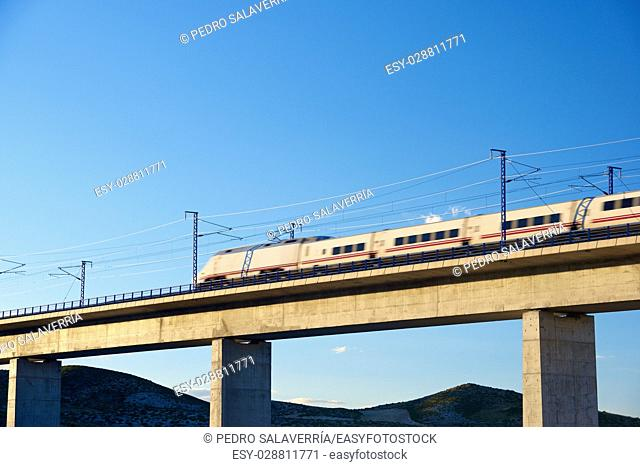 view of a high-speed train crossing a viaduct in Roden, Zaragoza, Aragon, Spain. AVE Madrid Barcelona